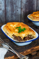 Steak and mushroom pie on rustic wooden backgournd