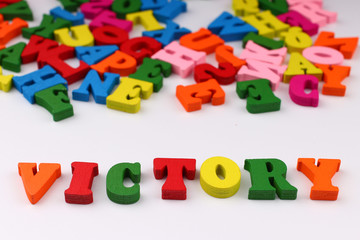 The word victory with colored letters
