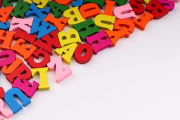 Colored letters close up which symbolize knowledge and learning copy space