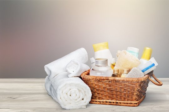 Bath towels and basket with accessories for spa on blur