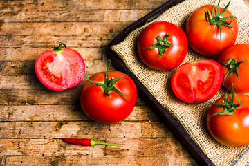 Tomatoes on a rustic wooden table