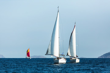 Sailing luxury boats during yacht regatta in the Aegean Sea at Greece.