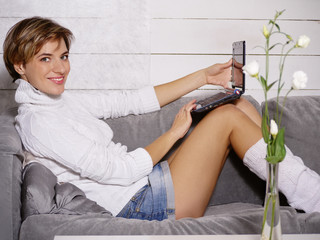 Smiling woman with laptop