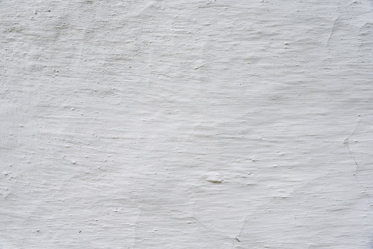 Adobe whitewashed wall, retro background with detailed texture, white color