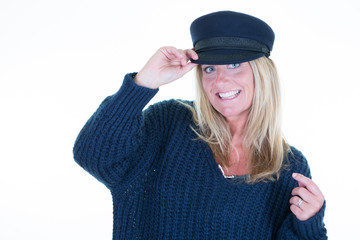 Portrait of nice 40 years old woman in marine sweater and caps