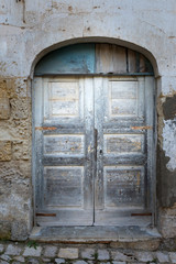 Old wooden door in ancient building