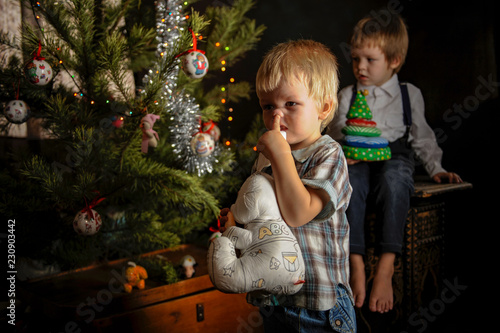 09e53bdc2c4 Two little cute boys from the shelter did not wait for gifts under the tree  from