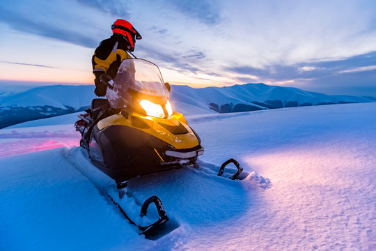 A rider on the snowmobile.