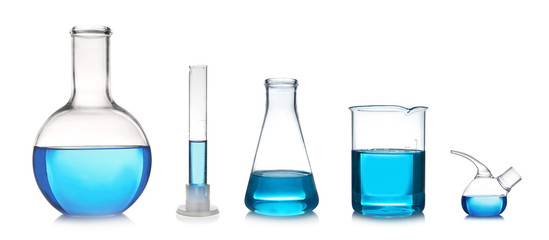 Fototapete - Set with different laboratory glassware and liquid for analysis on white background