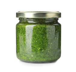 Homemade basil pesto sauce in glass jar on white background