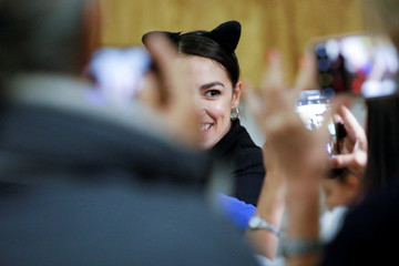 """Democratic Congressional candidate Ocasio-Cortez poses for photos as she attends the """"Halloween with Alexandria"""" event at St Paul's Evangelical Lutheran Church in the Bronx"""