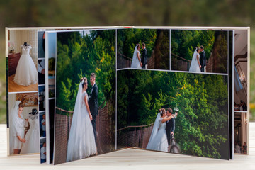 Open pages of brown luxury leather wedding book or album