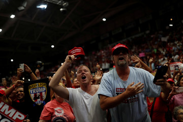 Supporters cheer at a campaign rally with U.S. President Donald Trump in Estero Florida