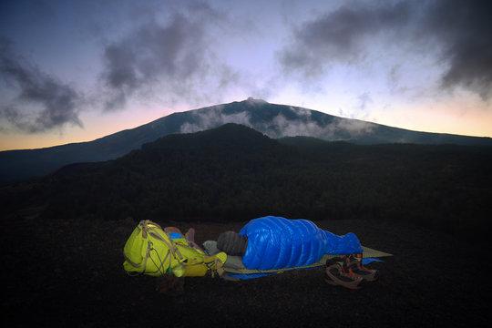 Hiker Is Sleeping In Blue Bag