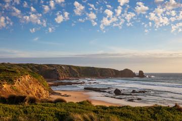 Cape Woolamai beach, looking towards the Pinnacles rock formation at sunset; Phillip Island, Victoria, Australia