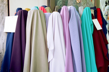 Beautiful of Satin has many colors as follows indigo, purple, violet, cream, brown, yellow, cyan, green, green, white, gray, grey, red. Fabric pastel color sell on market. Cloth texture background.