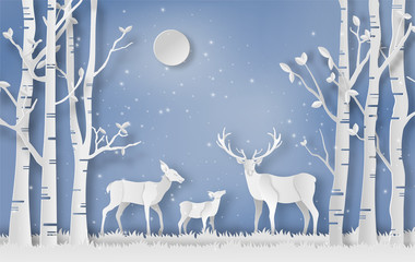 Paper art style of a deer family walks through a forest during winter, flat-style vector illustration.