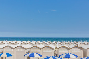 Huts and umbrellas on the beach of Lido in Venice, Italy