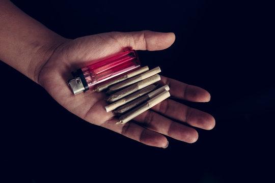 marijuana joints and light on hand