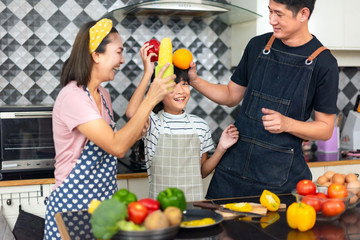 Happy family mother and father teaching cute girl preparing making Wheat flour  and Make a fruit cake healthy at kitchen for the first time. first lesson and healthy lifestyle concept.