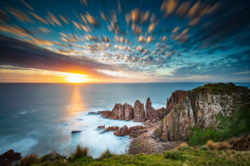 Dramatic long exposure image of the sunset overlooking the Pinnacles a famous rock formation on Phillip Island, Victoria Australia Wall mural