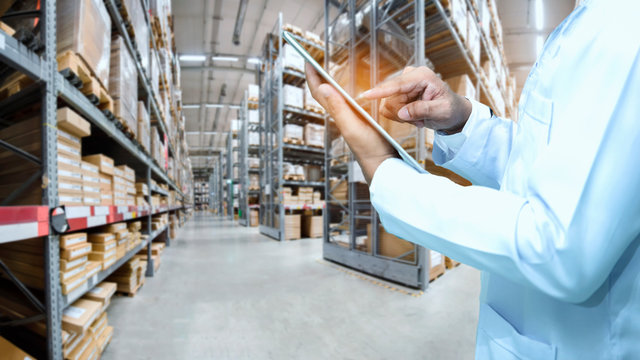Warehouse worker or supervisor or checker check stock