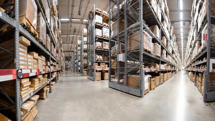 Panorama huge distribution warehouse with high shelves