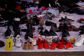 Recovered shoes believed to be from the crashed Lion Air flight JT610 are laid out at Tanjung Priok port in Jakarta