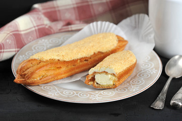cake Eclair whole and cut on a plate