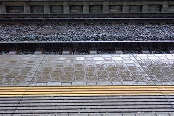 rail way platform witg gray pavement