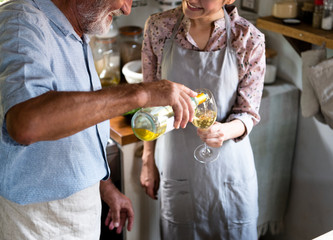 Couple having wine in a countryside kitchen