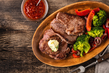 Door stickers Meat Grilled Beef steak with garlic butter and vegetables. Meat with grilled bell pepper, broccoli and onions.