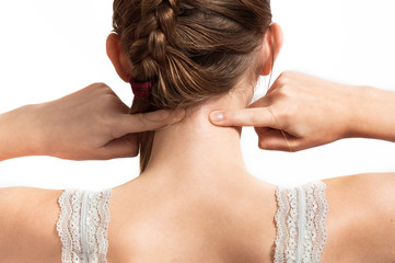 young girl makes herself an acupressure, an approximate look from  back