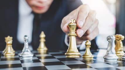 Businessman playing chess game reaching to plan strategy for success, thinking for planning overcoming difficulty and achieving goals business strategy for win, management or leadership concept