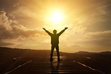 Men raise their arms to thank God.