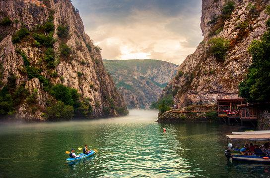 Canyon Matka near Skopje with people kayaking and amazing foggy scenery