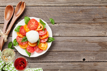 Caprese salad with rose and white wine