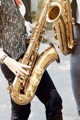 Girls playing wind instruments