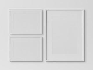 White rectangular frames hanging on a white wall mockup 3D rendering