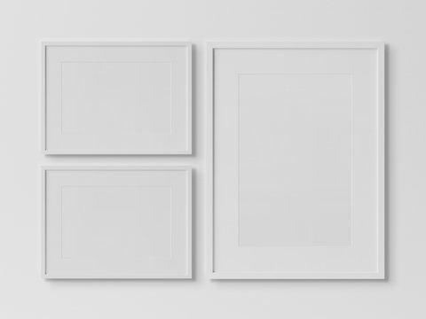 White rectangular frames hanging on a white wall mockup 3D rendering
