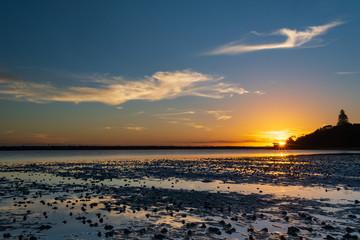 Sunset over Harrington Lagoon, Australia. Cloud reflections on a still day on New South Wales mid north coast.