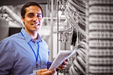 Portrait of technician analyzing server