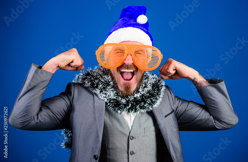 2e3f60cdb0d Guy tinsel ready celebrate new year. Corporate party ideas employees will  love. Corporate christmas party. Man bearded hipster wear santa hat and  funny ...