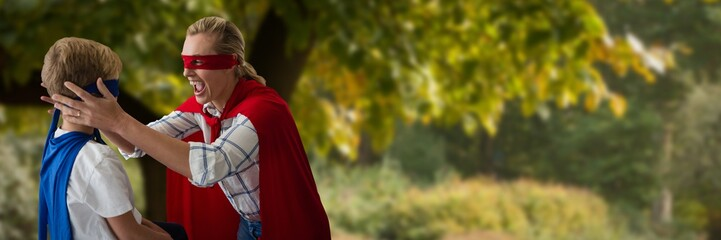Composite image of mother and son pretending to be superhero