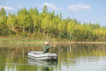 Senior fisherman fishing from his drift boat