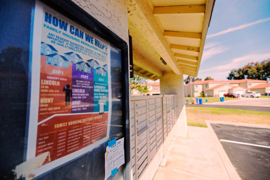 A poster containing information pertaining to military housing issues is shown at a mail box in a military neighborhood on base at Camp Pendleton