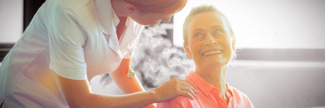 Female nurse consoling senior woman