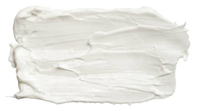 Smear of white face cream texture. A sample of a cosmetic product, body cream. Isolated on white background.
