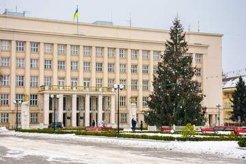 Uzhgorod, Ukraine - JAN 9, 2017: Christmas tree in the city center. Lovely postcard of Regional Administration building on Narodna square