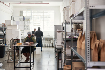 People at work together in an artisanal chocolate making factory